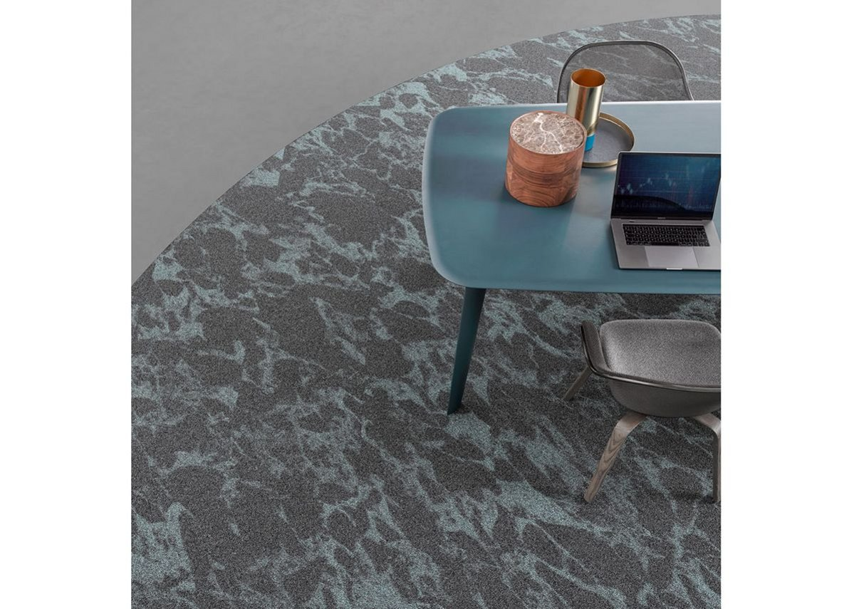 Desso Resonance carpet tiles and Tarkett iD Square luxury vinyl tiles can be used together to zone open-plan spaces.