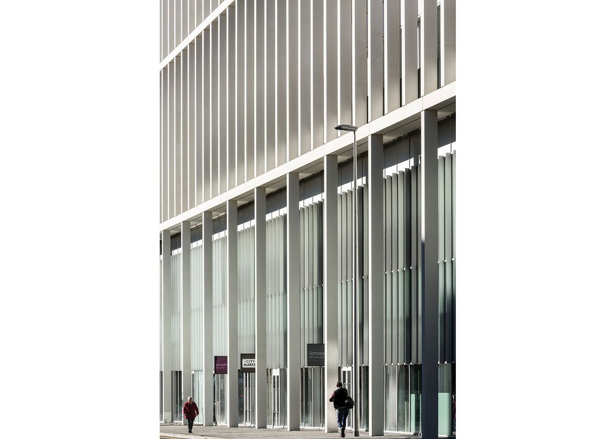 Layered gridded façade creates a civic language that addresses and activates cathedral street