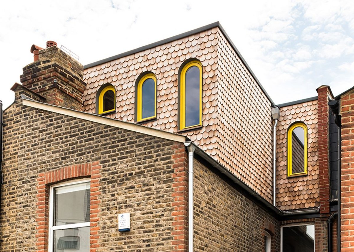 Valetta House upwards extension owlishly enlivened by yellow window frames, designed by Office S&M.