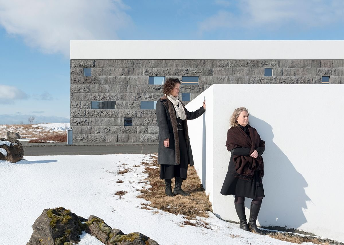 Hrefna Björg Þorsteinsdóttir & Hólmfríður Ósmann Jónsdóttir of Arkibullan photographed by Ivan Jones at the Þjónustubyggingar cemetery buildings at Gufunes Cemetery, from the exhibition Architects at the King's Cross Visitor Centre.