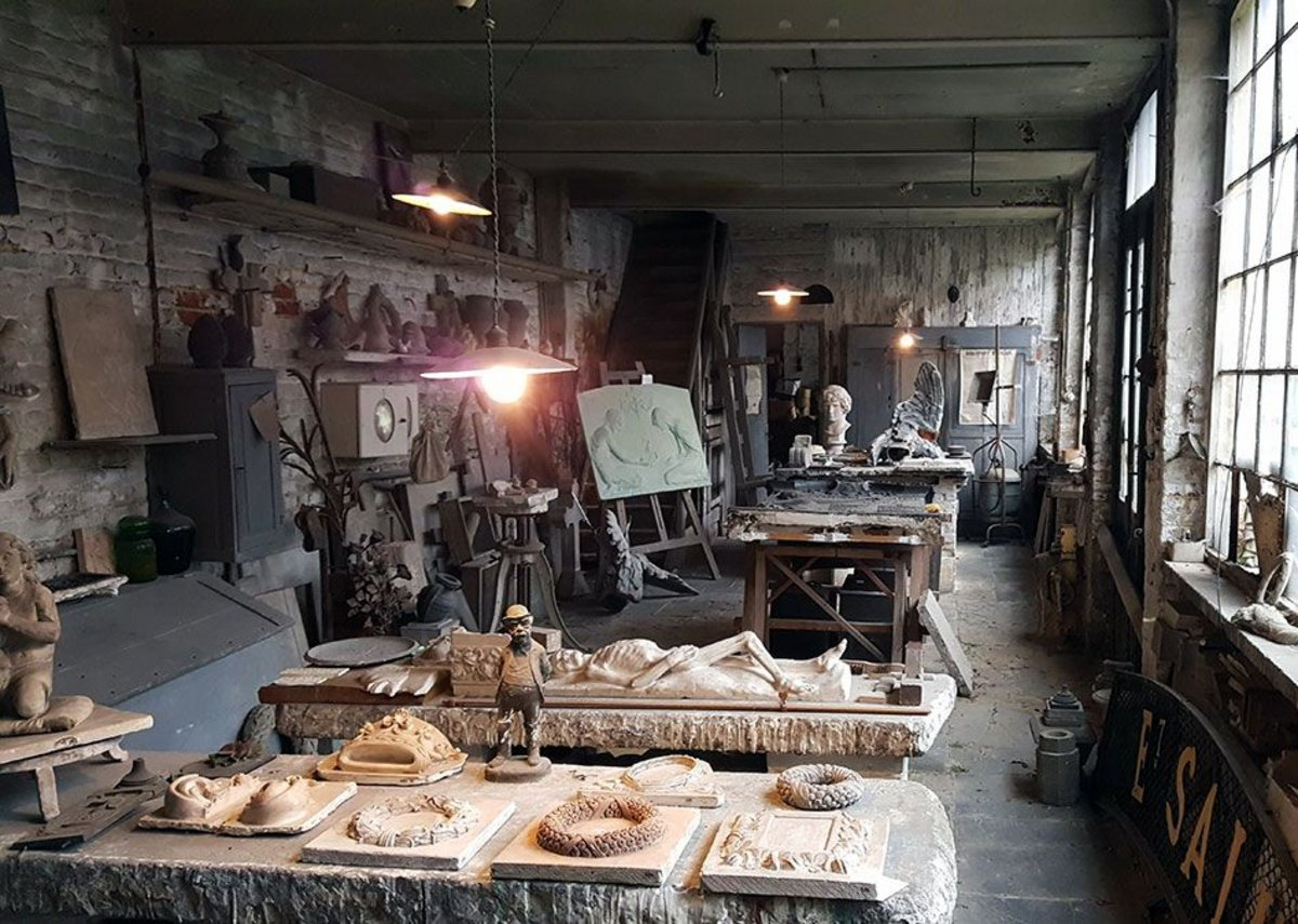 One of the workshops at the studio of Ernest Salu. The backyard overlooks the Laeken Cemetery.