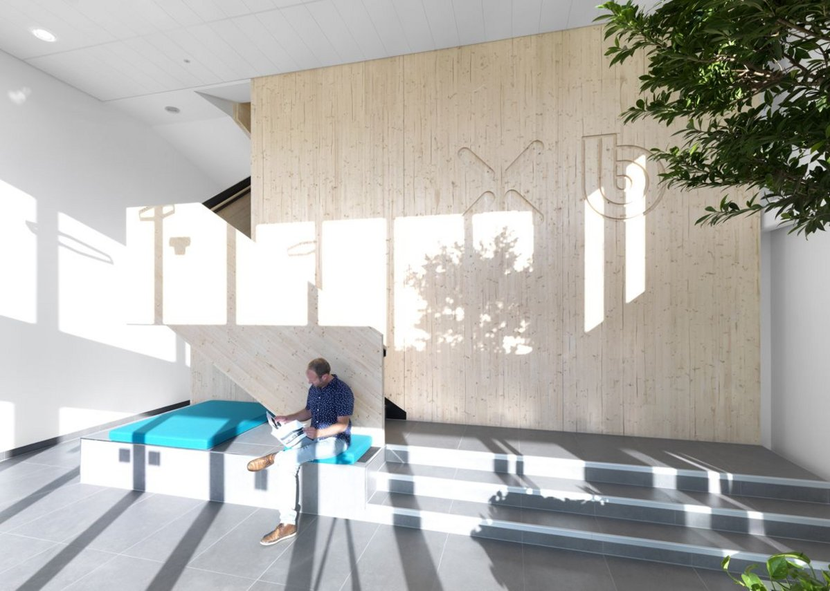 At the ground floor reception, the timber wall and stair are a cameo for what goes on beyond.