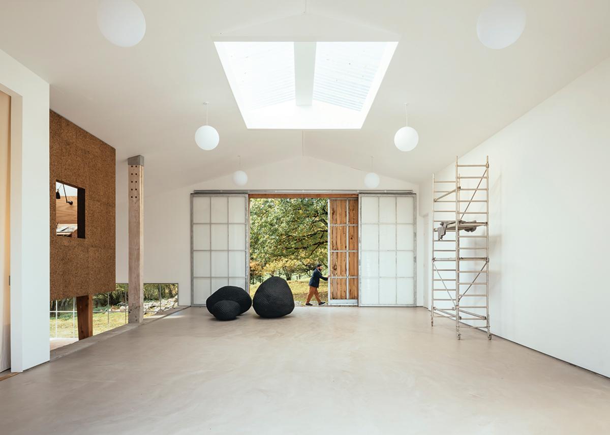 The cork-clad Winter Studio overlooks the toplit gallery.
