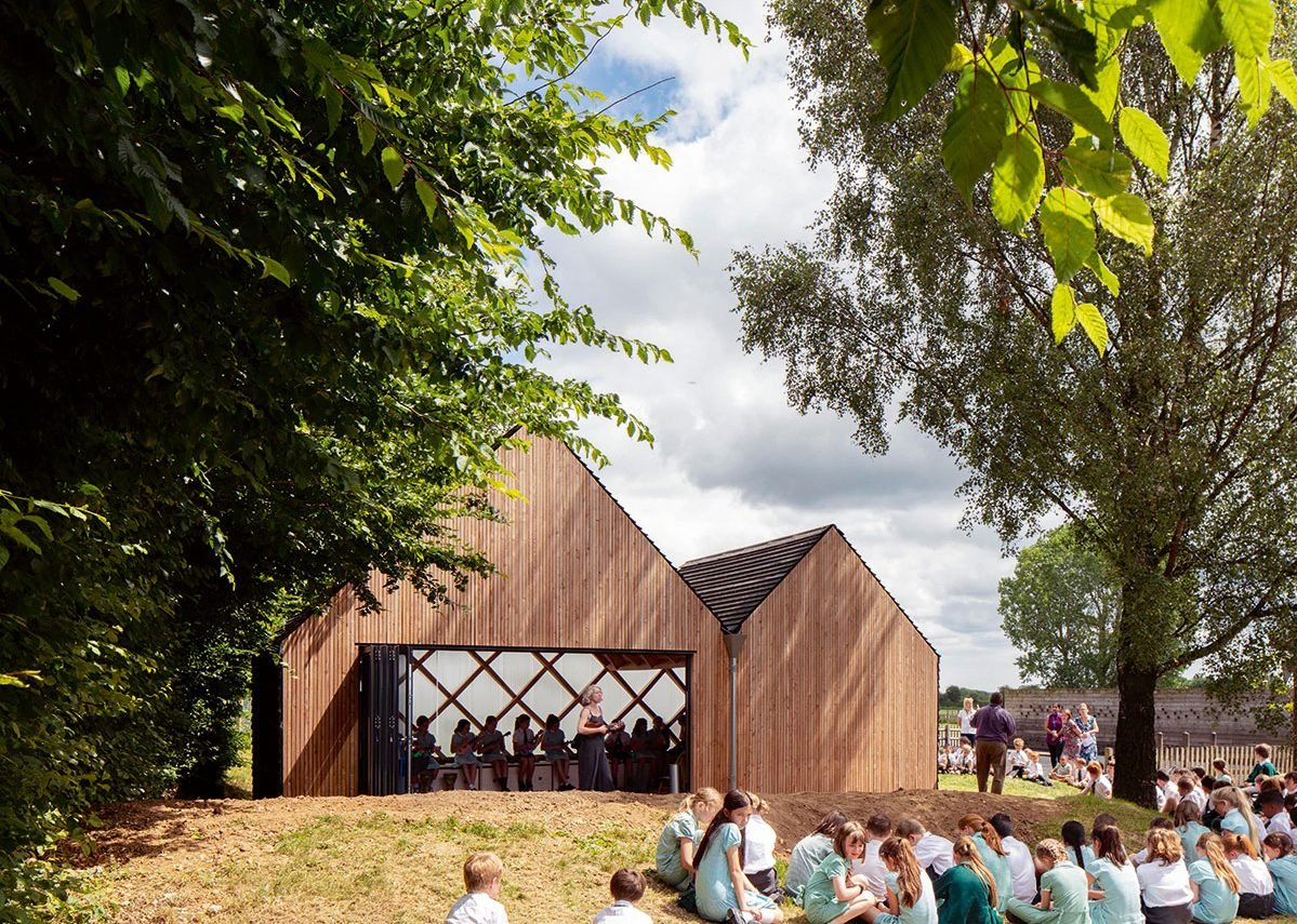St. John's School Music Pavilion designed by Clementine Blakemore Architects at Lacey Green, Buckinghamshire. Bi-folding doors open the space up to the school landscape.