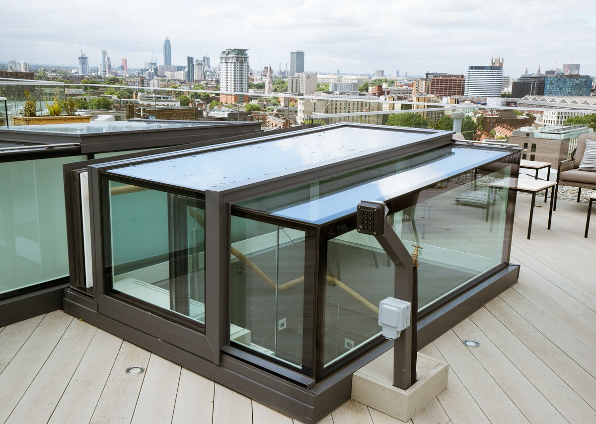 SPPARC Architects' Music Box apartments in London feature roof terrace boxlights by Glazing Vision.