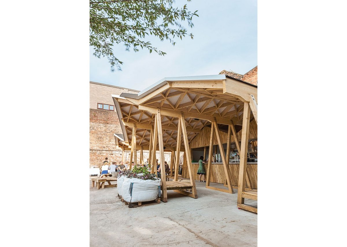 Trestles that support the roof double as seating.