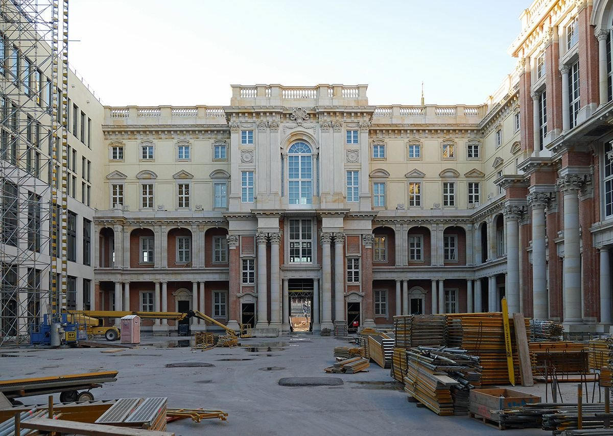The museum's main courtyard nears completion, red brickwork awaiting its coat of stucco.