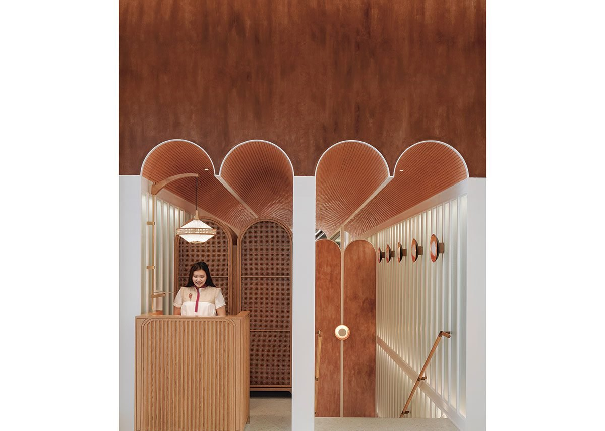 Reception desk at John Anthony, a dim sum restaurant in Hong Kong fusing the architecture of East and West.