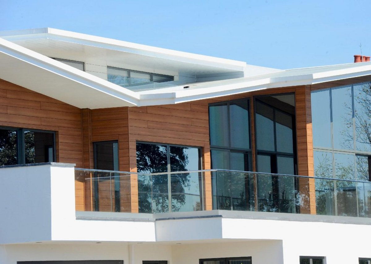 Trespa Pura NFC cladding in Romantic Walnut and White Pine on a property in Hayling Island, Hampshire.