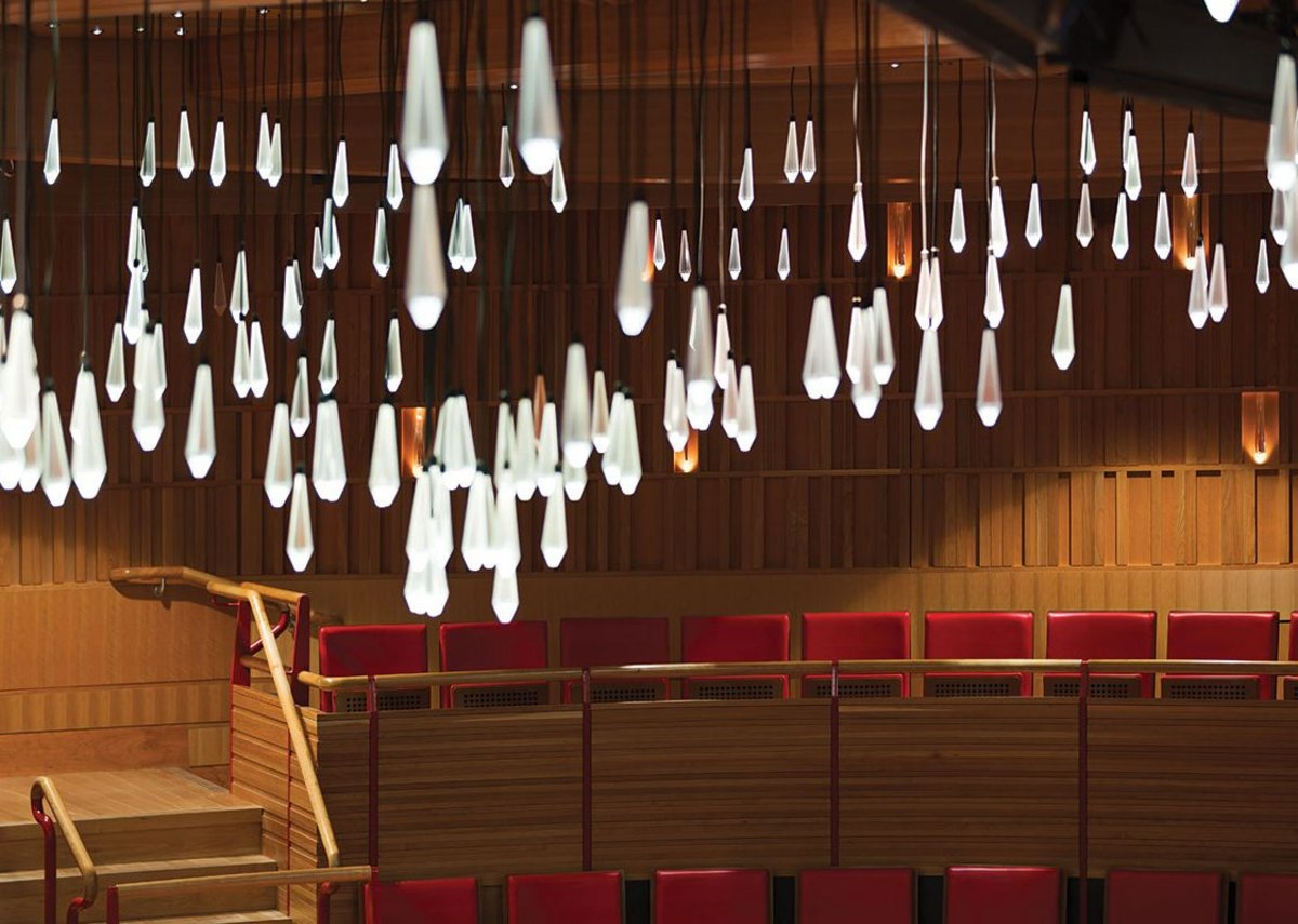 Pendants reference the historical use of candles to light theatres.