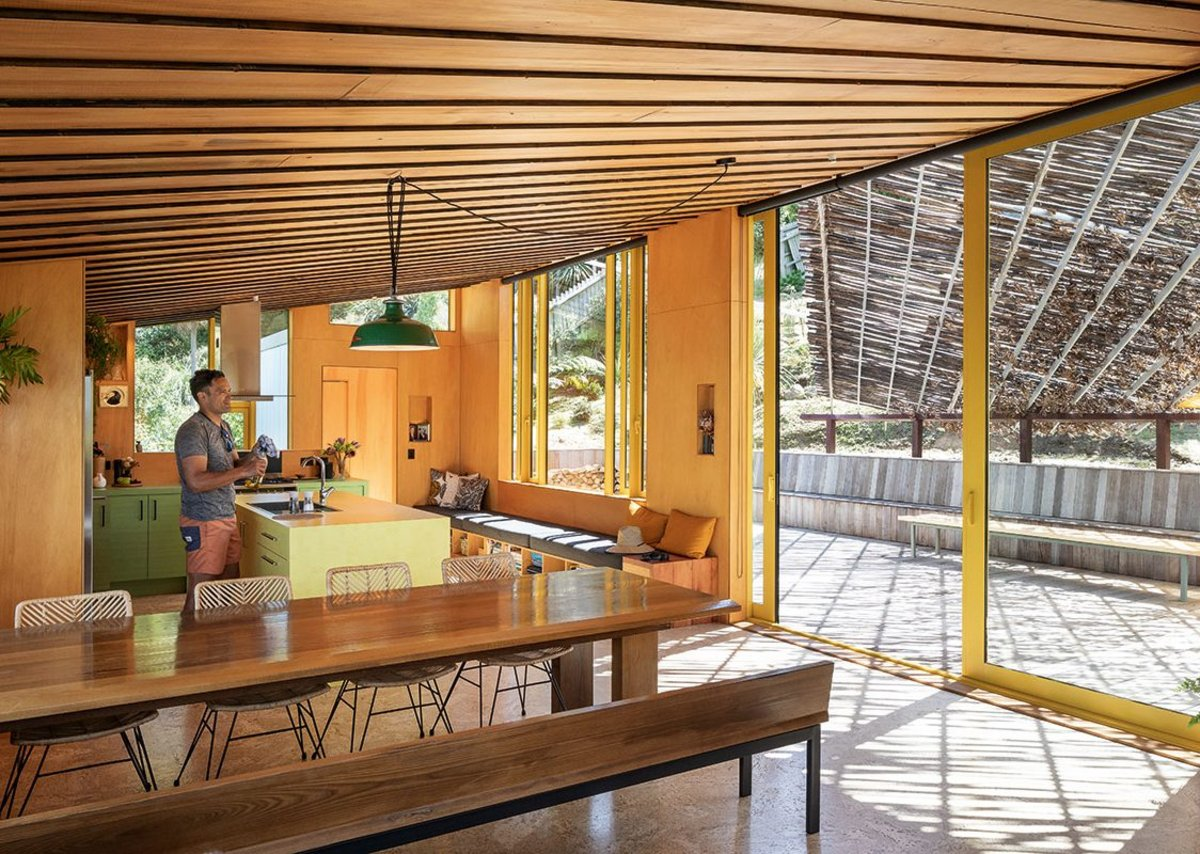 A plywood pavilion crowns the house and subverts the traditional whare form.