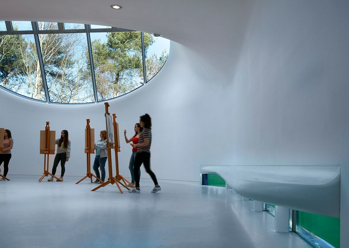A bench grows from the curves, underneath a window. It works.