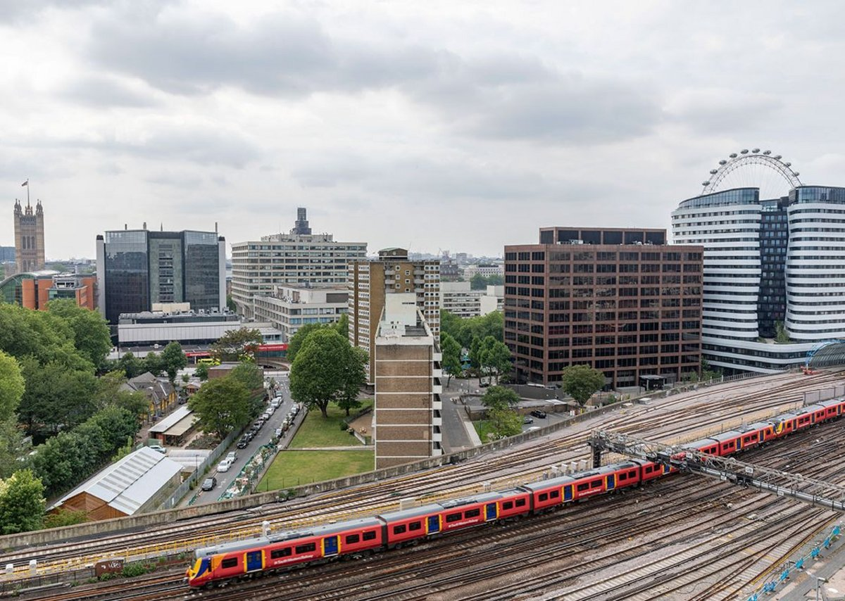 The strip of Waterloo City Farm is overlooked by far larger buildings: social housing, a train viaduct, Westminster's Victoria Tower and the hospital buildings of Guy's and St Thomas' Charity.
