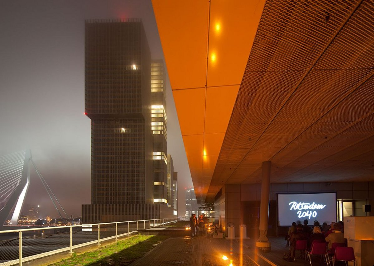 Rooftop screening overlooking OMA's de Rotterdam and UNStudio's Erasmus Bridge.