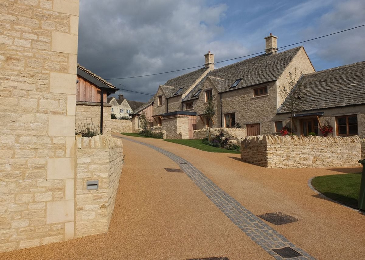 One of the two short terraces which have fitted six new homes onto this old builders' yard. MacEwen Award shortlisted Sly's Close, Northleach, Gloucestershire. Mungo Park Architects
