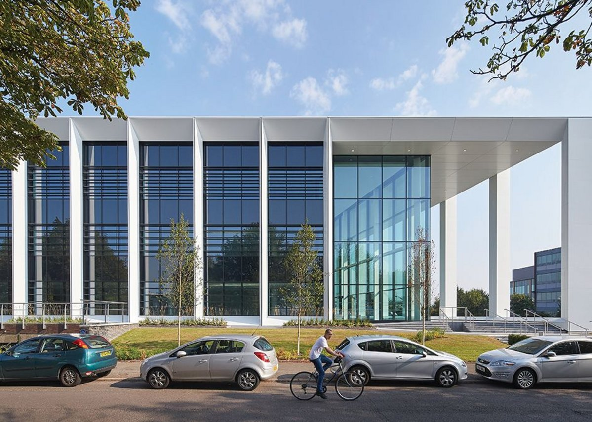 Side elevation, showing canopy, reception and horizontal brise soleil within the full height glazing.