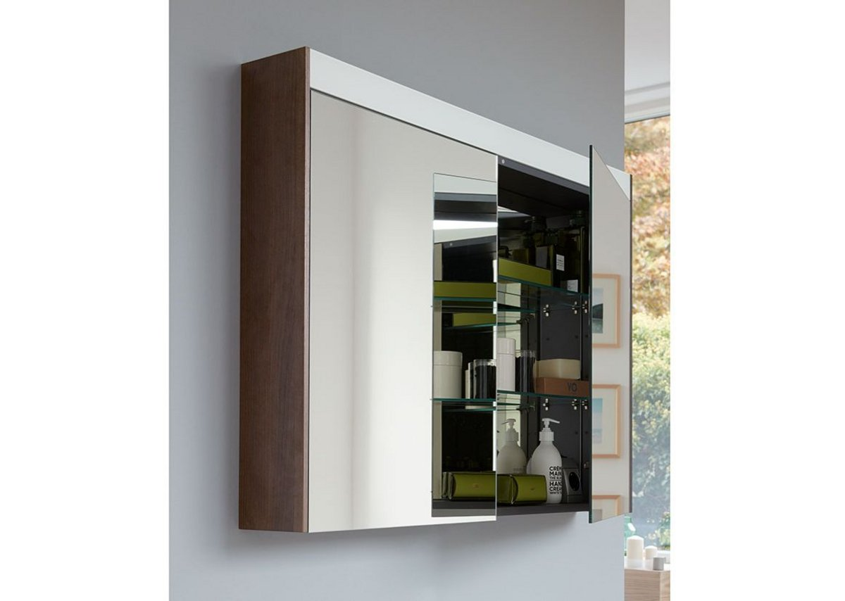 Matching mirror cabinets feature a LED lighting strip across the top with contact-free control.