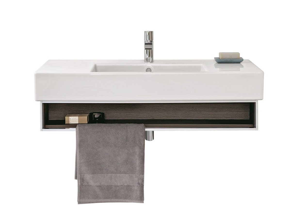 The open compartment features a shiny chrome frame and also serves as an integrated towel holder.