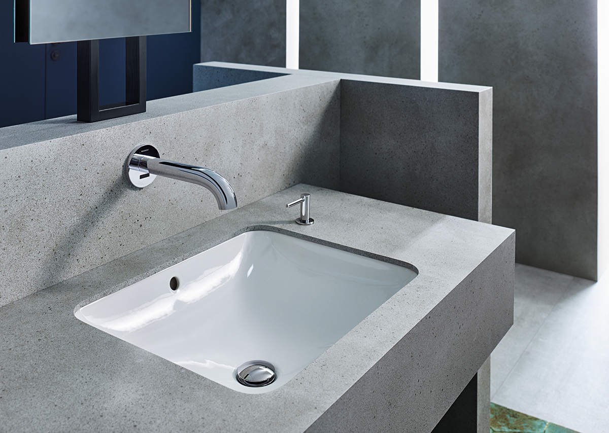 Water-saving and hygienic. Geberit Piave touchless taps fit seamlessly into any office washroom design.