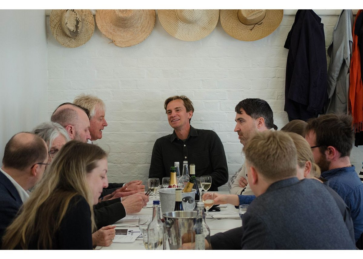 At the head of the table under the Rochelle Canteen's straw hats, MacEwen Award winner Dominic Gaunt of Ayre Chamberlain Gaunt, talking to judge Iain Tuckett (far left) of Coin Street Community Builders.