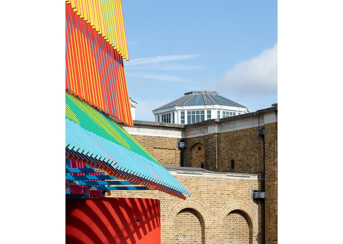 The Colour Palace, a summer pavilion designed by Pricegore and Yinka Ilori at the Dulwich Picture Gallery, 2019.  The pavilion rises to the same height as the tallest roof light on Soane's nearby gallery.