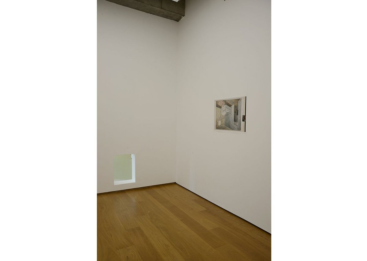 Becky Beasley, OUS installation view, 2017.  The Bedstead has been inverted. The void cut in the wall relates to the blank space on the wall in the waterpainting. Towner Art Gallery, Eastbourne.