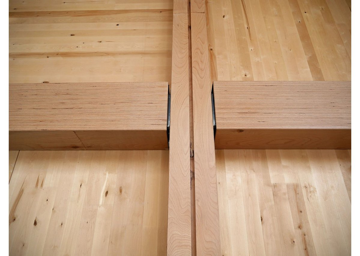 The laminated beech beams slot neatly together.