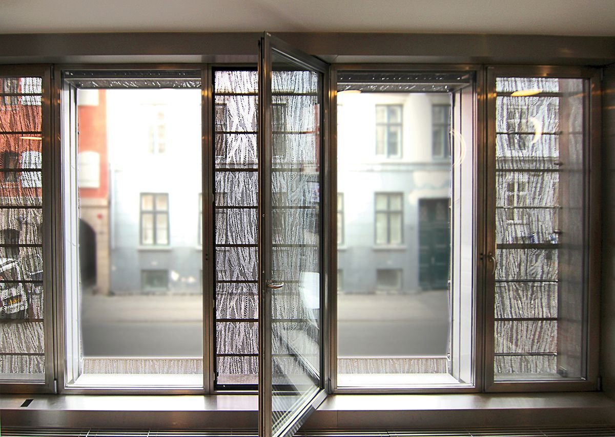 Looking out through the facade from inside the building, patterns in the mesh can be clearly seen.