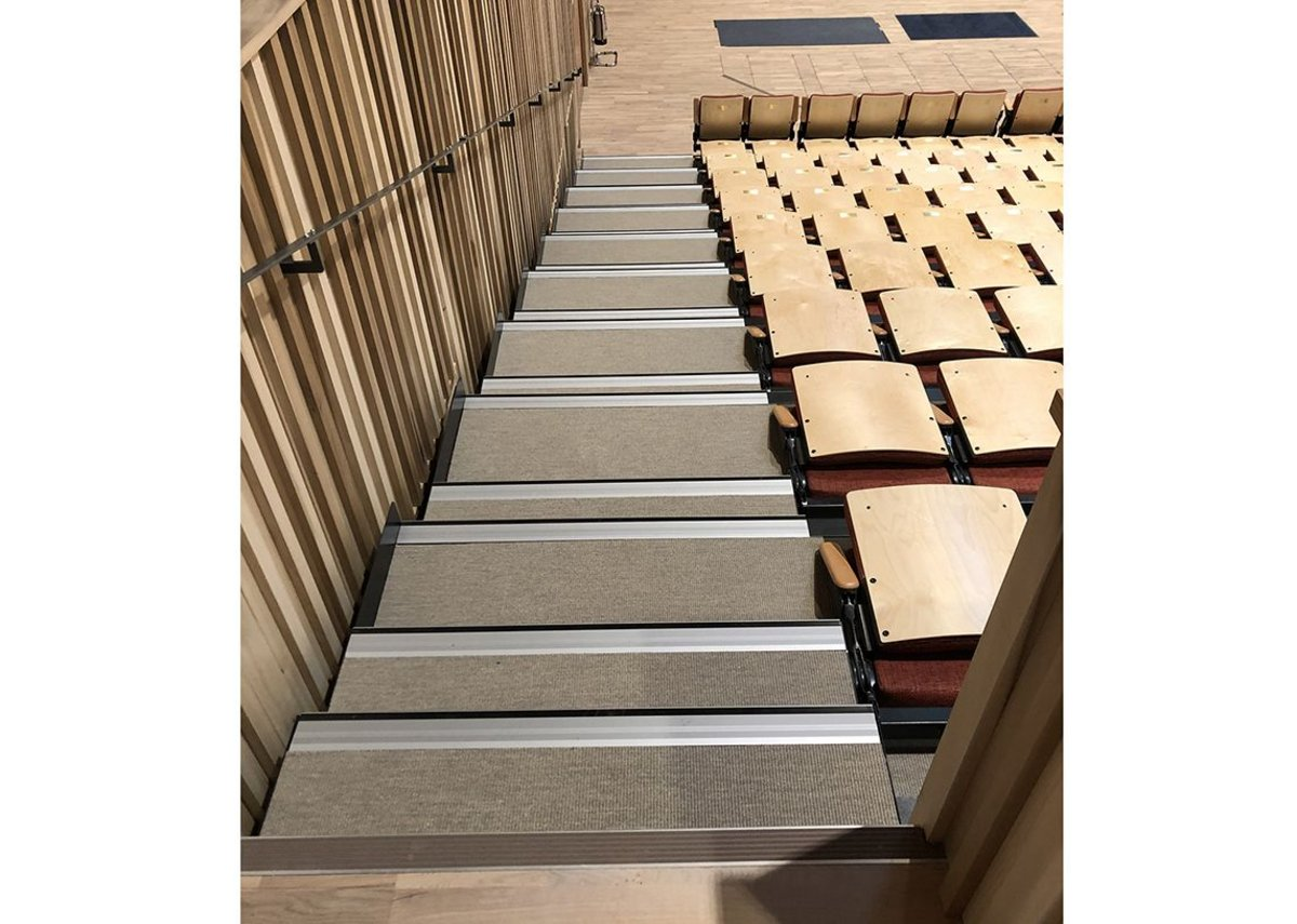 Sherborne Girls school, Dorset. Danfloor's Nordform Classic XL carpet was selected for the steps of the auditorium's retractable seating platform and the practice rooms.