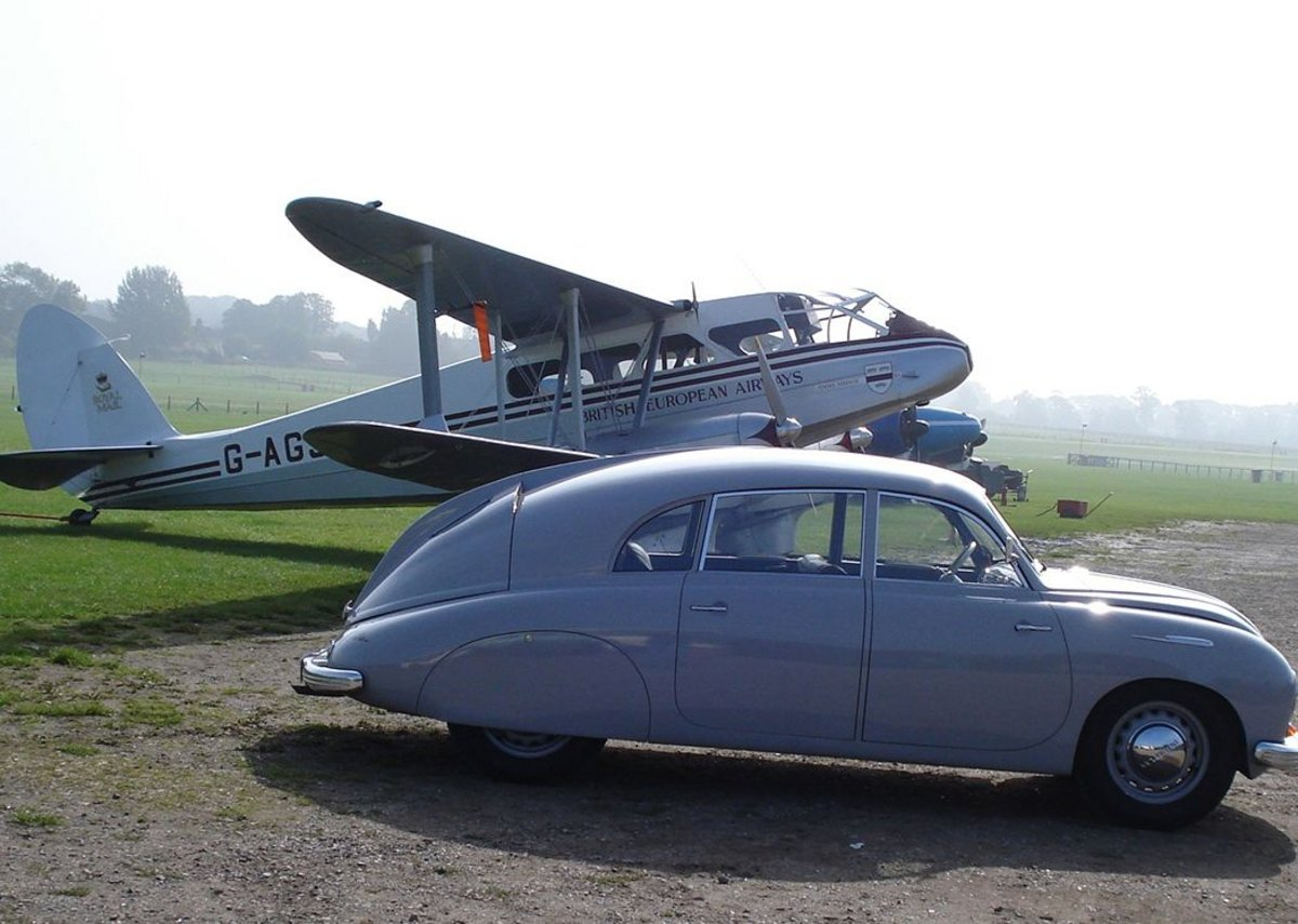 Margolius owns this 1949 Tatra T600 Tatraplan, seen here with a de Havilland biplane.
