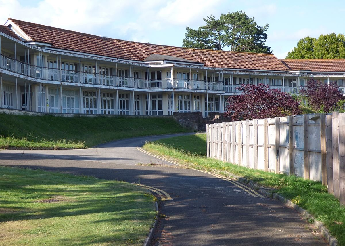The balconies on West's Benenden sanatorium are later additions. He rejected the idea of balconies on the grounds that they would give opportunity for cross-infection.
