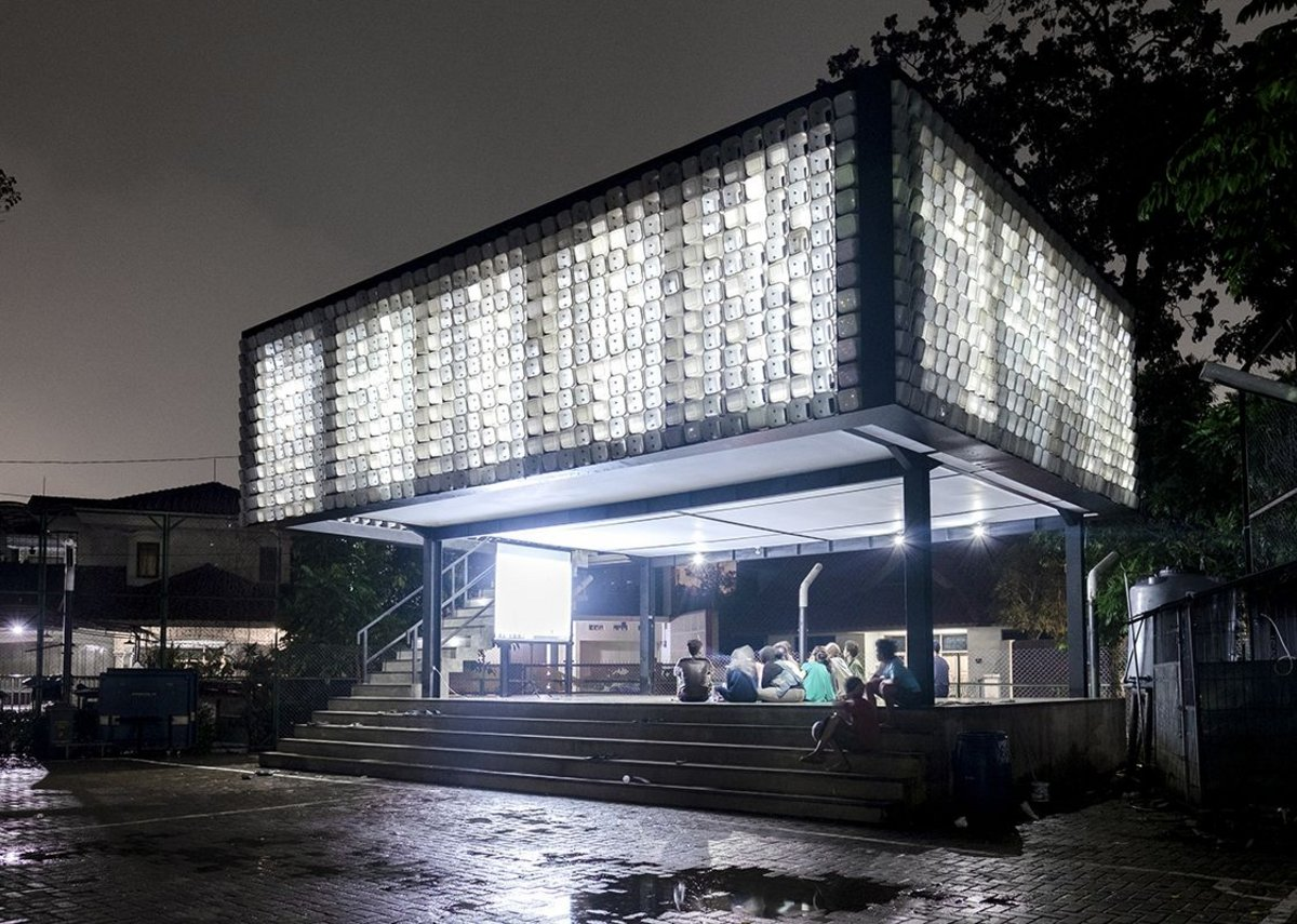 Microlibrary at Taman Biman, Indonesia, designed by SHAU Indonesia using a facade of plastic ice cream buckets inserted into metal frames.