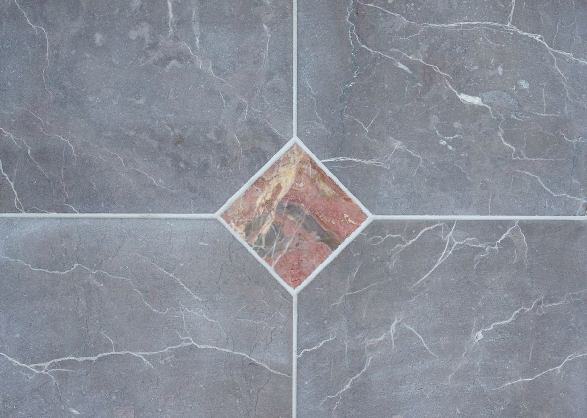 Soft grey Claughton tiles paired with Red Ogwell in a matt finish