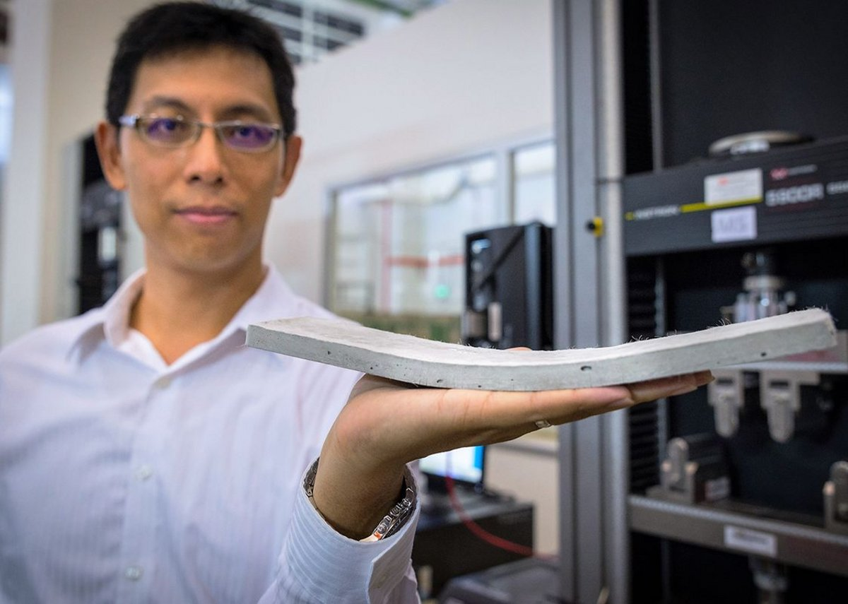 NTU Asst Prof Yang En-Hua holding the bendable concrete developed by his team.