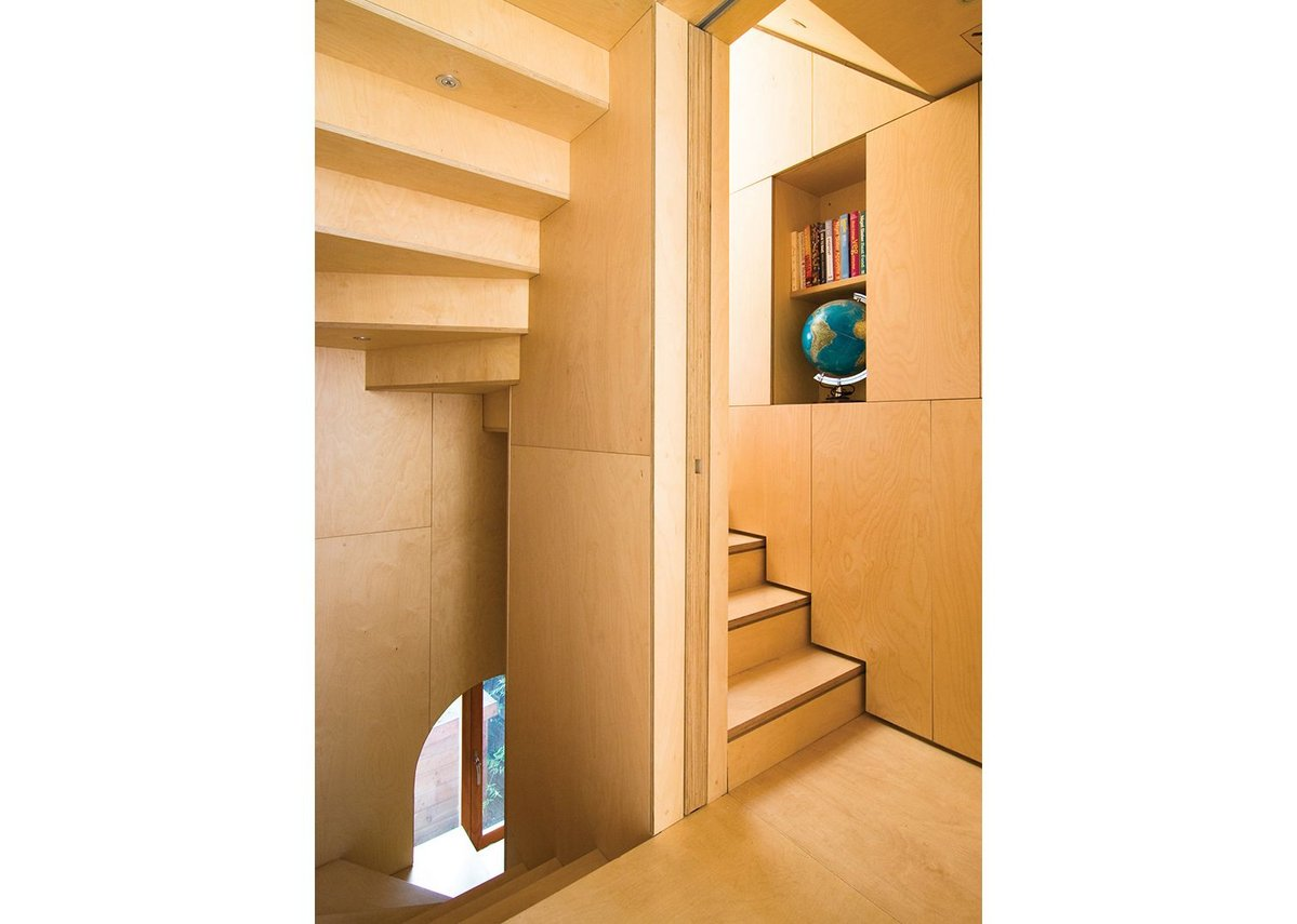 The plywood stair is atthe heart of the building.