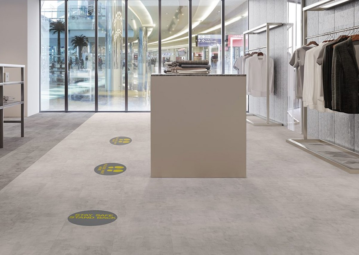 Amtico Stay Safe Stand Back and Please Wait Here.