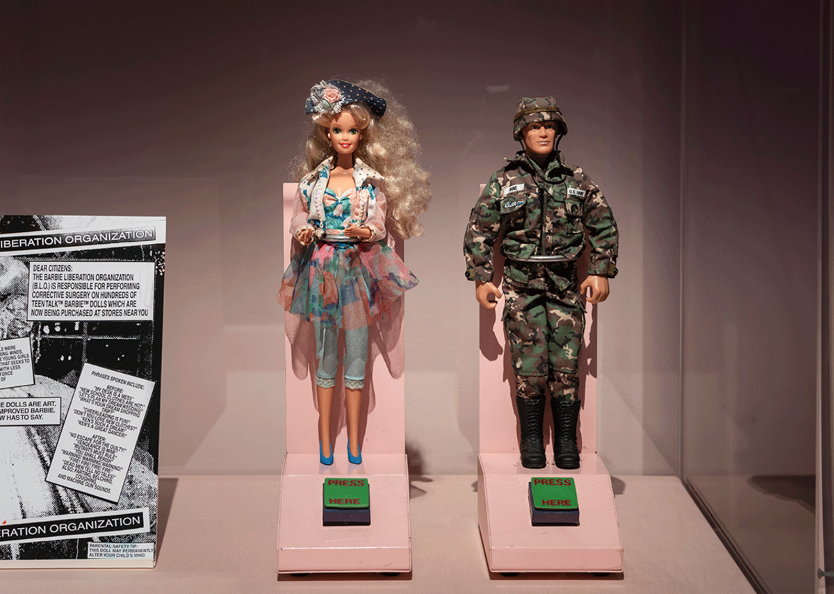 Installation shot of exhibits relating to the Barbie Liberation Organization at the Play Well exhibition at the Wellcome Collection.