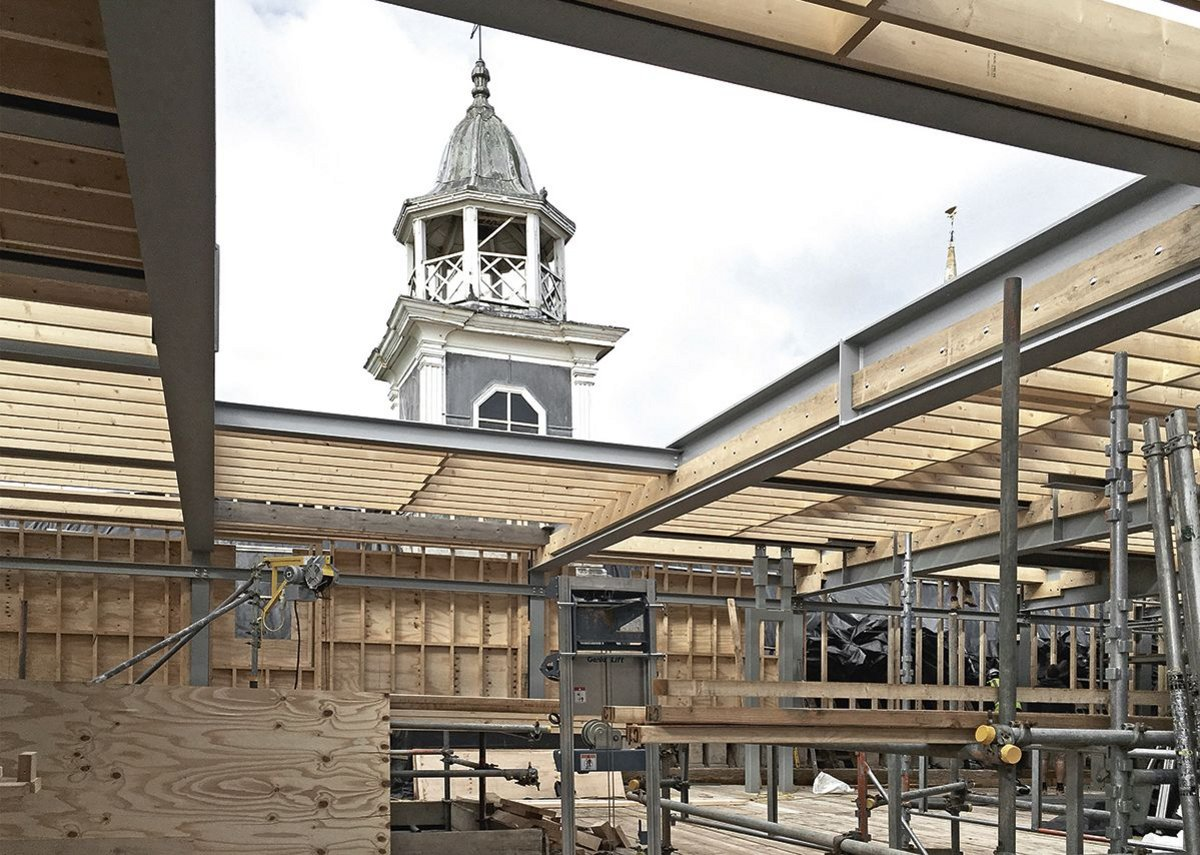 The new steel and timber roof respected the wall line of the courtyard.