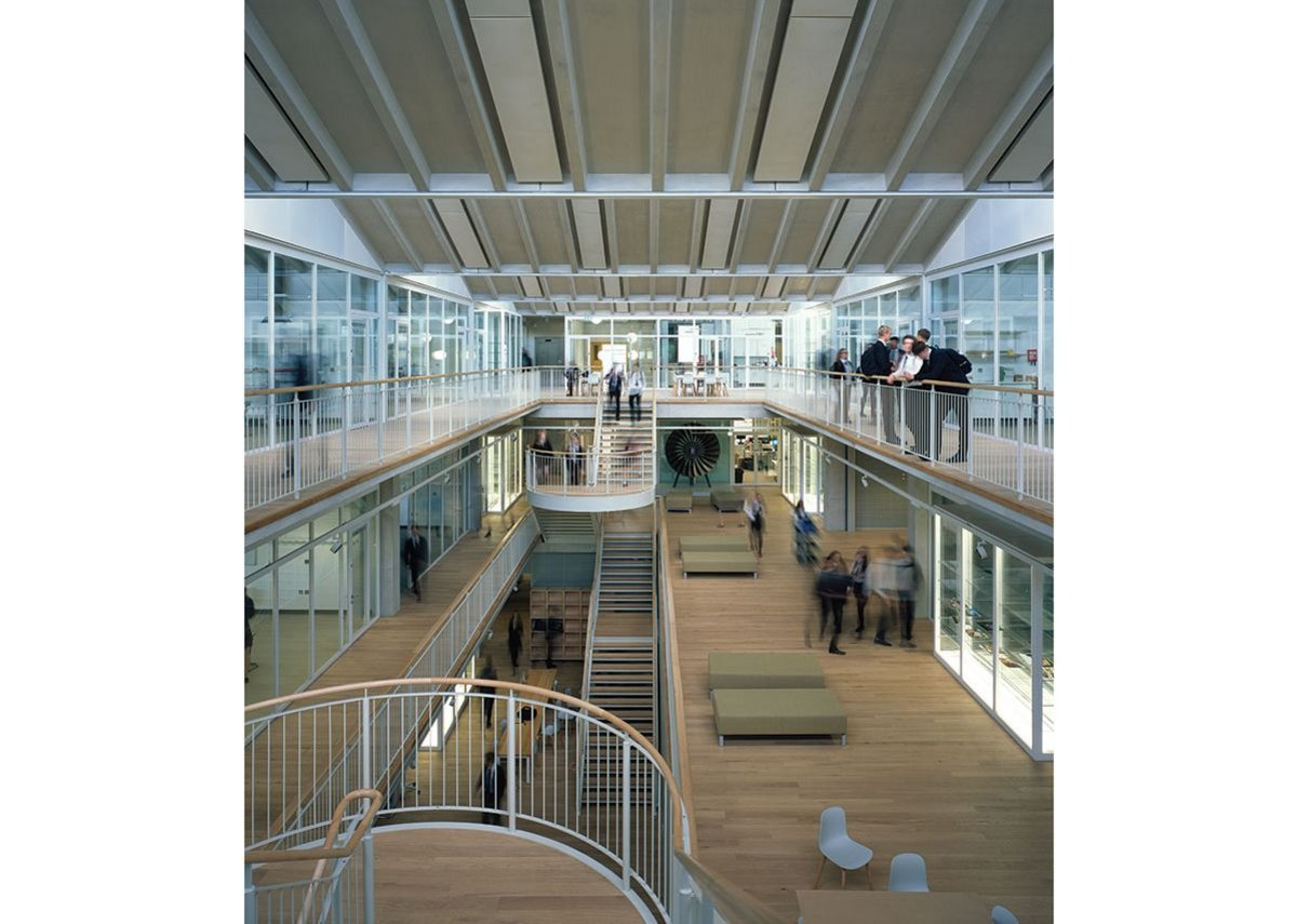 Circulation spaces around the atrium are broad enough to house informal working areas.