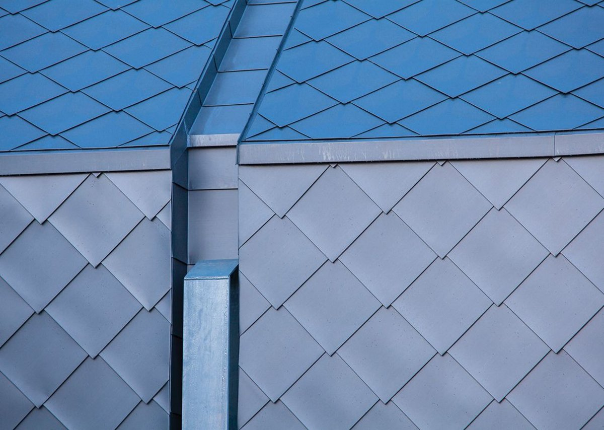 Detailing of the NEDZink shingles is crisp – particularly around the 'dolphins' holding the steel guide post for the house to move up along.