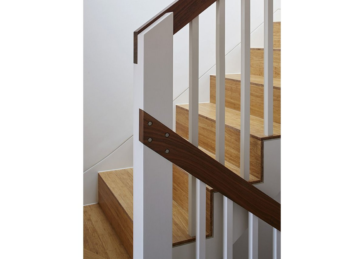 Details of post and banisters and in the treads lends an airy texture to the staircase.