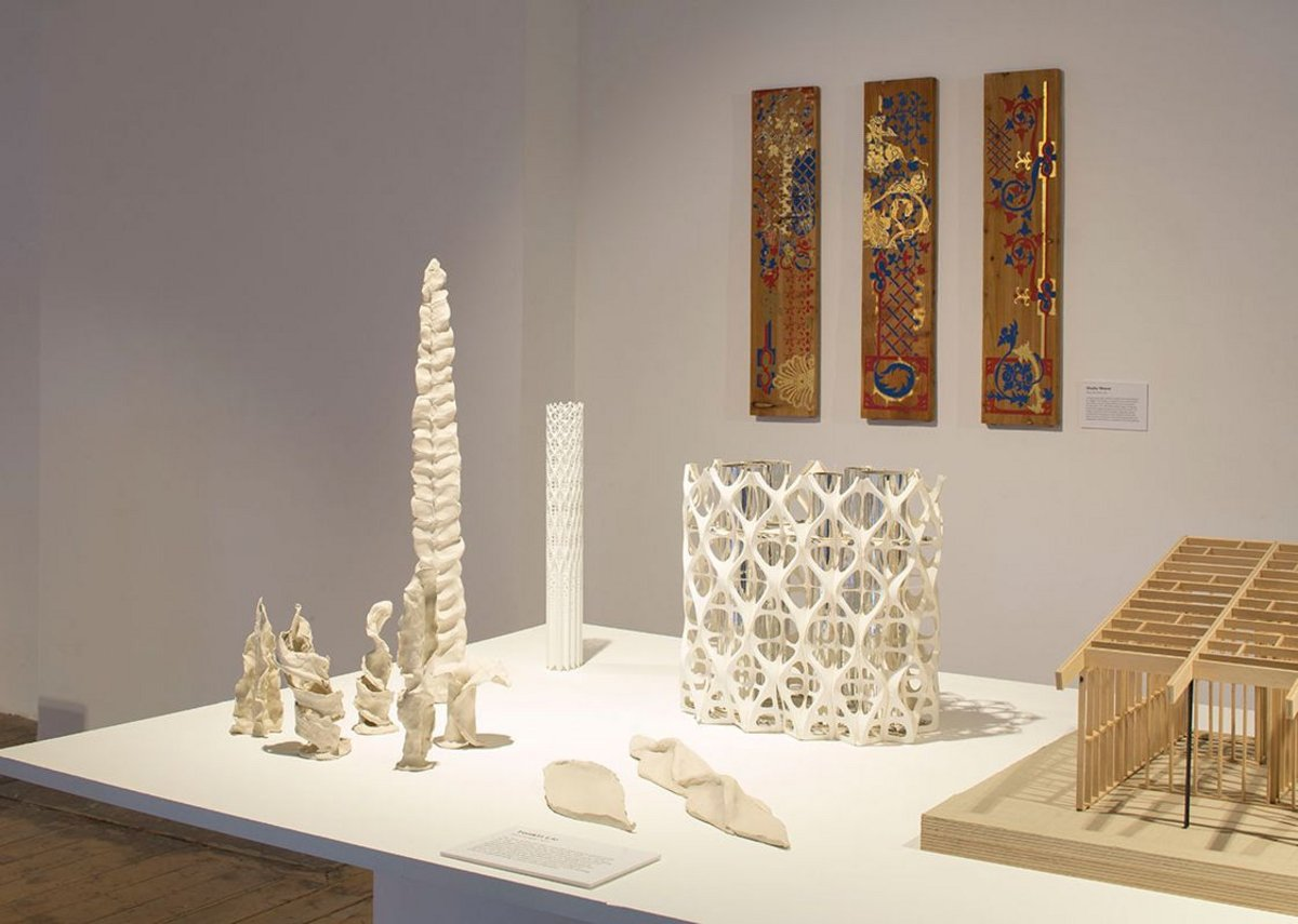 Installation view of Architecture Prototypes & Experiments showing Tonkin Liu's plasticine, paper and 3D printed models of the Tower of Light.
