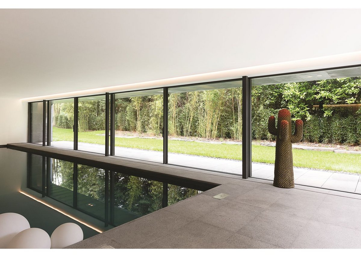 Floor to ceiling glazing from Reynaers at a house designed by Atelier d'Architecture Bruno Erpicum in Belgium.