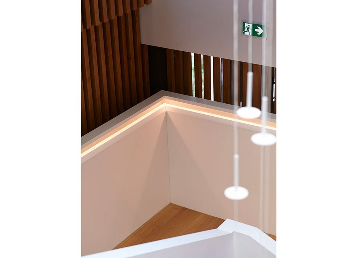 Handrail with recessed joints and angled lighting.