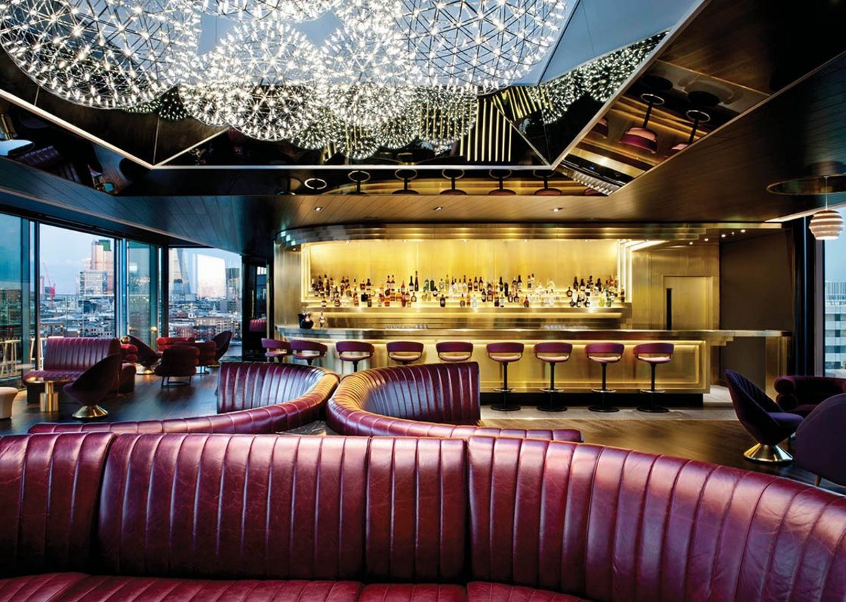 Pendants resembling firework explosions and sensuous red leather couches in the Rumpus Room bar on the roof.