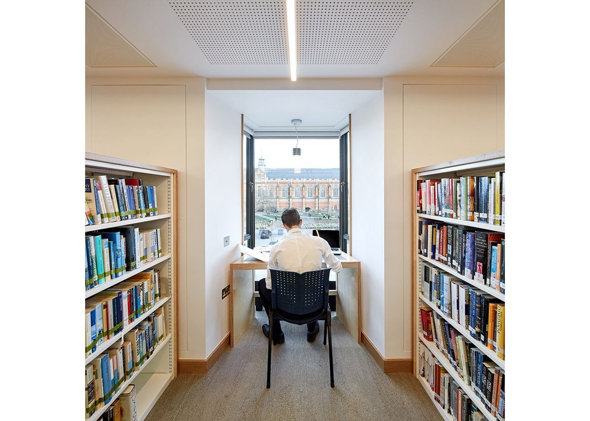 …have been replaced by eye-level shelving that creates views along the length of the building.