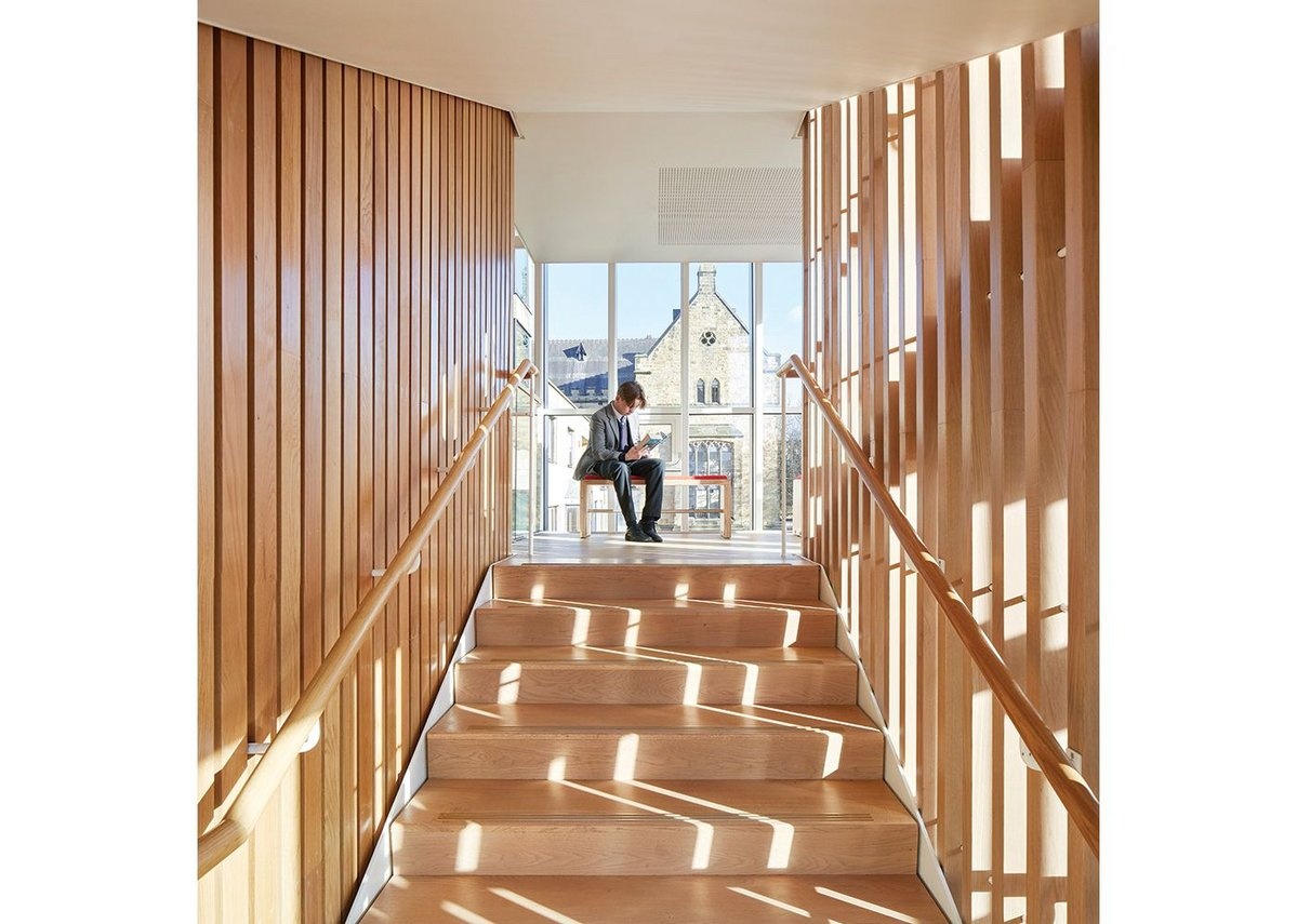 Generous stair landings create spaces for stopping and thinking.