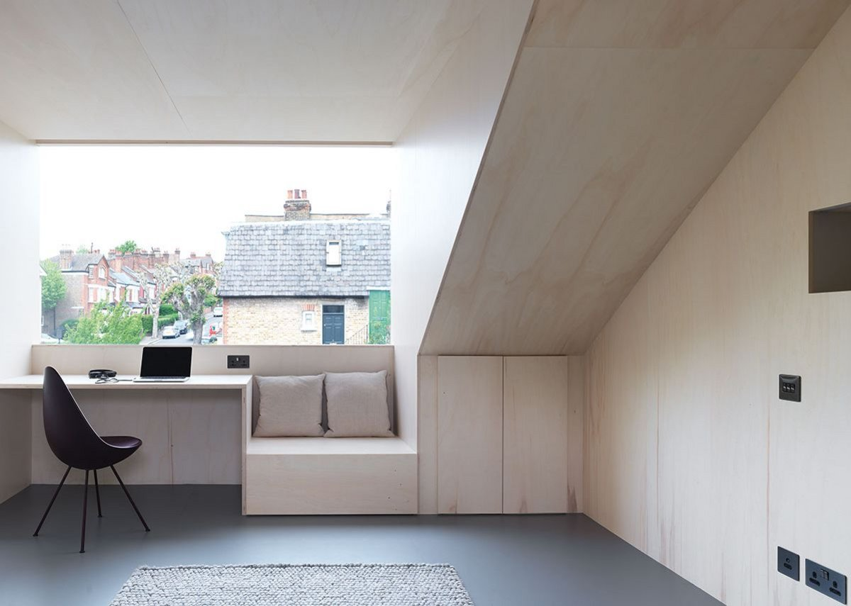 Loft at Stapleton Hall Road, London, united by pale poplar ply.