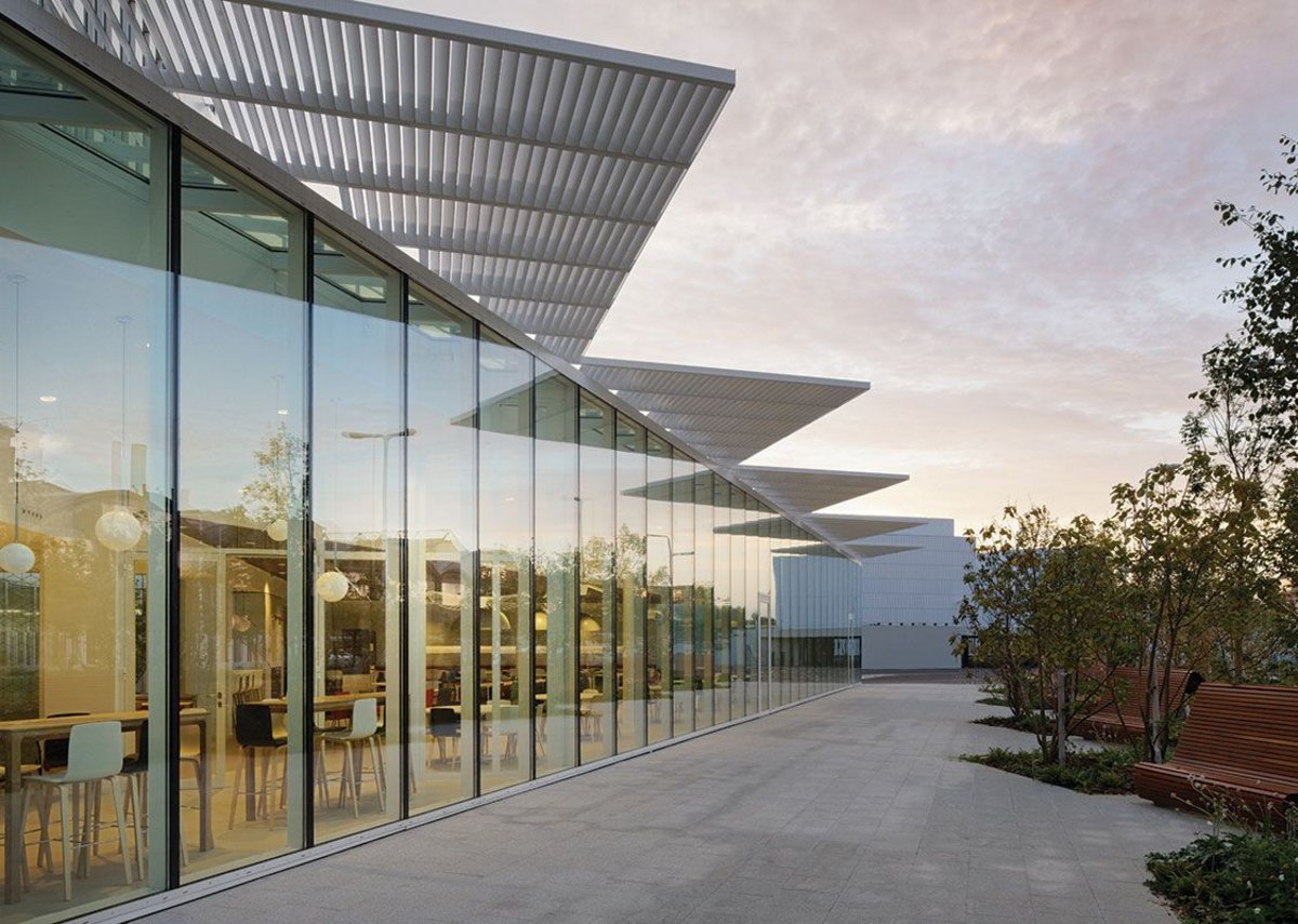 3.3m high double-glazed units facing south over the parking and landscaped area are the most open aspect of the building.