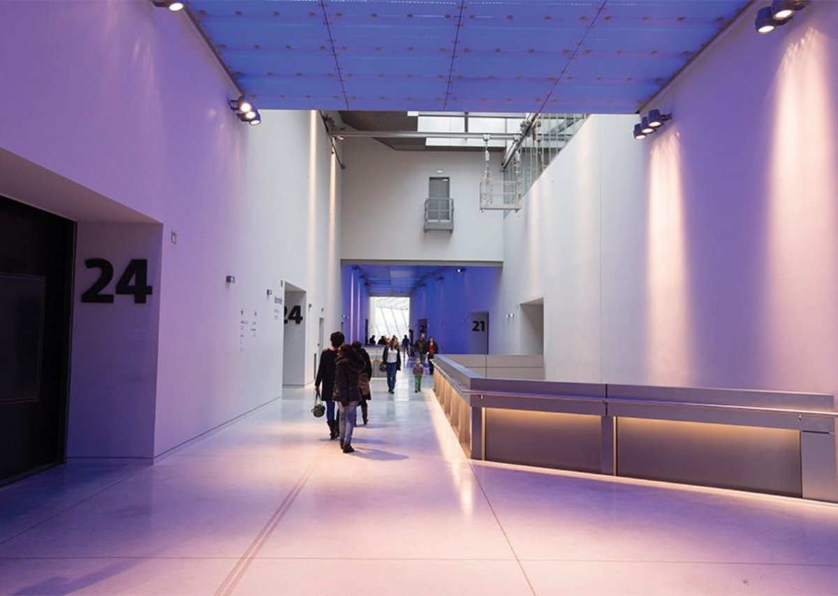 The central corridor between exhibition halls runs back to a view of the confluence.
